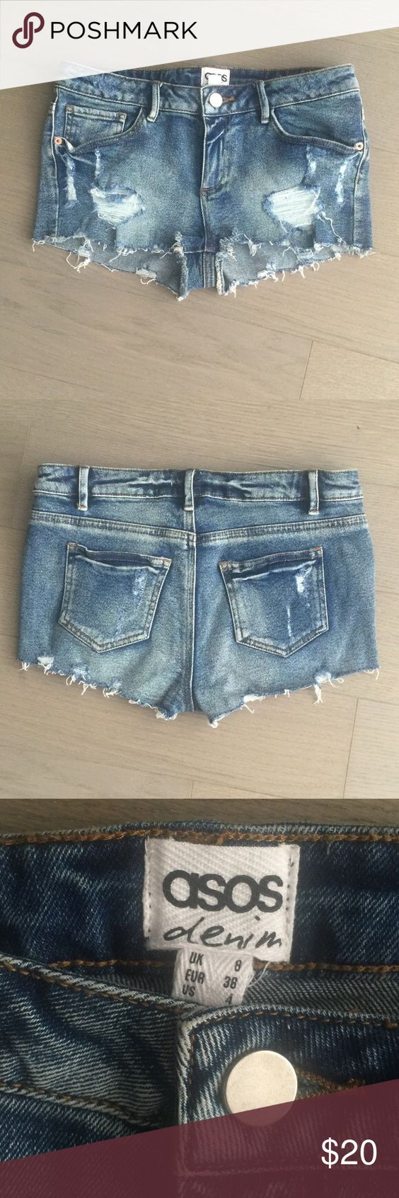 ASOS destroyed low-rise denim cutoff shorts,  blue ASOS size 4 destroyed-look low-rise shorts in faded medium blue color with pockets and zipper and button closure. Excellent summer staple. Asos Shorts Jean Shorts