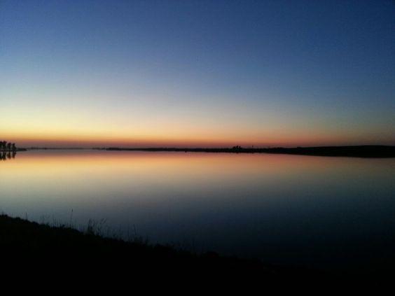 South Dakota prairie lake at sunset