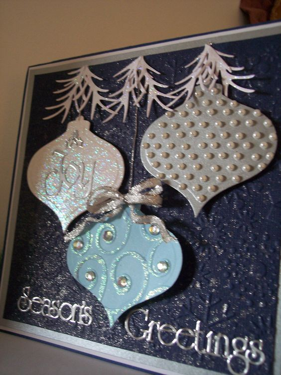 SB Heirloom ornaments with Bling and Cheery Lynn pine branches. Snowflake CB embossing folder and Sparkle Spritz on navy paper.