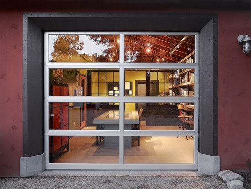Of Course Garage Doors Need Not Only Be Used On Garages Here A Garage Style Door With Clear Panels Shows Off A Lo Garage Doors Garage Style Glass Garage Door