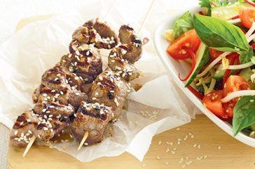 Sesame beef skewers with Thai salad main image