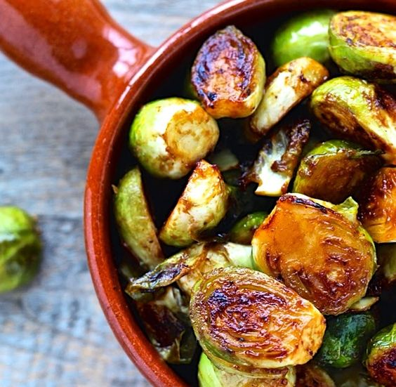 Miso Roasted Brussels Sprouts. These tasty little cabbages are coated with a salty sweet glaze and each bite is an umami flavor bomb!