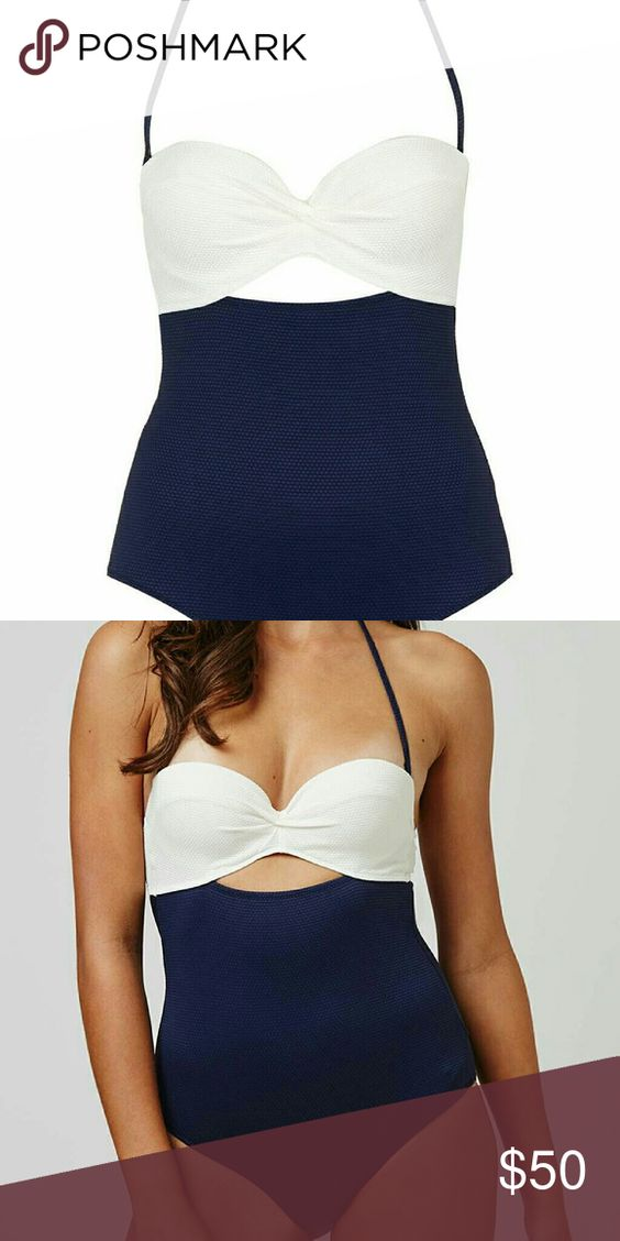 Topshop one piece cut out swimsuit Size 10 topshop navy and white cut out swimsuit. Never worn. Fits like a medium Topshop Swim One Pieces