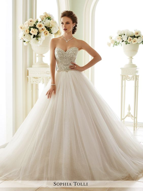 Sophia Tolli - Strapless misty tulle over sequin tulle ball gown with sweetheart neckline, rich crystal hand-beaded embroidery adorns bodice, back corset, sparkling gathered full skirt with chapel tra