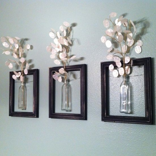 """""""Dollar store frames, Dollar aisle (IKEA) vases, wrapped with floral wire around the vases and secured with a dot of glue. Added floral stems in the top and hung in my bathroom.  $12"""""""