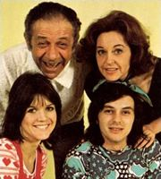 Bless This House. Image shows: Sally Abbott (Sally Geeson), Sid Abbott (Sid James), Mike Abbott (Robin Stewart), Jean Abbott (Diana Coupland). Image credit: Thames Television.
