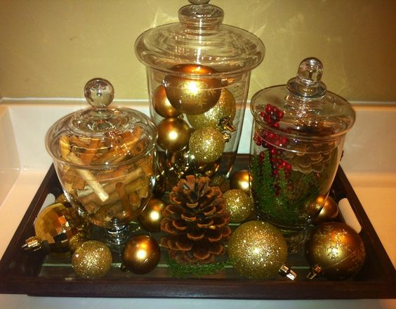 Apothecary jars in bathroom filled with extra shimmer...   holidays