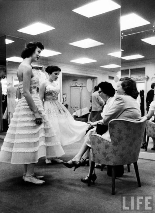 High school girls trying on prom dresses at Saks Fifth Ave in ...