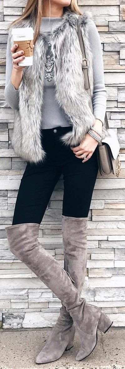 gray over the knee boots, black jeans, gray fur vest, gray shirt, winter outfit