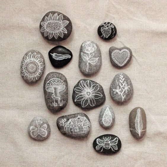 Pebbles painted and floated wood