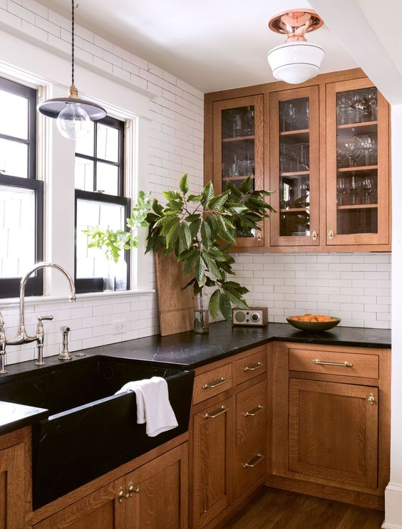 This remodeling is what we have based our initial inspiration on. We like the marriage of old and new, in addition to the color palette. The black trim on the windows is also quite attractive.