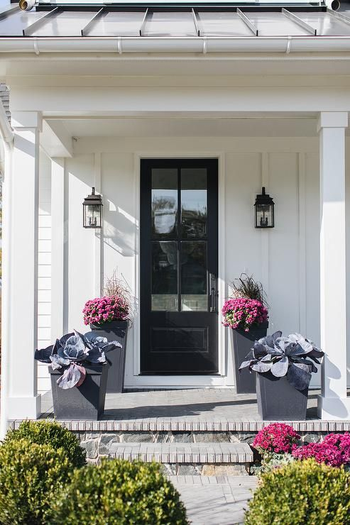 Modern Black Planters Sit On A Covered Porch Complementing A White