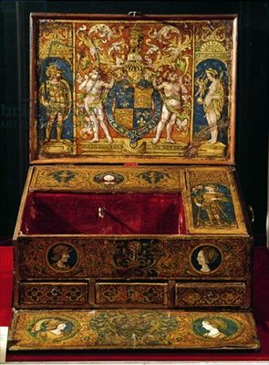 belonging to King Henry VIII (1491-1547) showing the heraldic badges of Henry and his first wife, Katherine of Aragon and the royal coat of arms; covered with shagreen added in 18th century; figures of Mars, Venus and Cupid; head of Christ; St. George and the dragon; Catherine of Aragon;16th (C16th) Writing box or table desk, probably painted by Lucas Hornebolte (c.1492-1544) c.1525-27 (walnut & oak with painted & gilded leather)