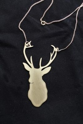 gold deer necklace. so pretty!