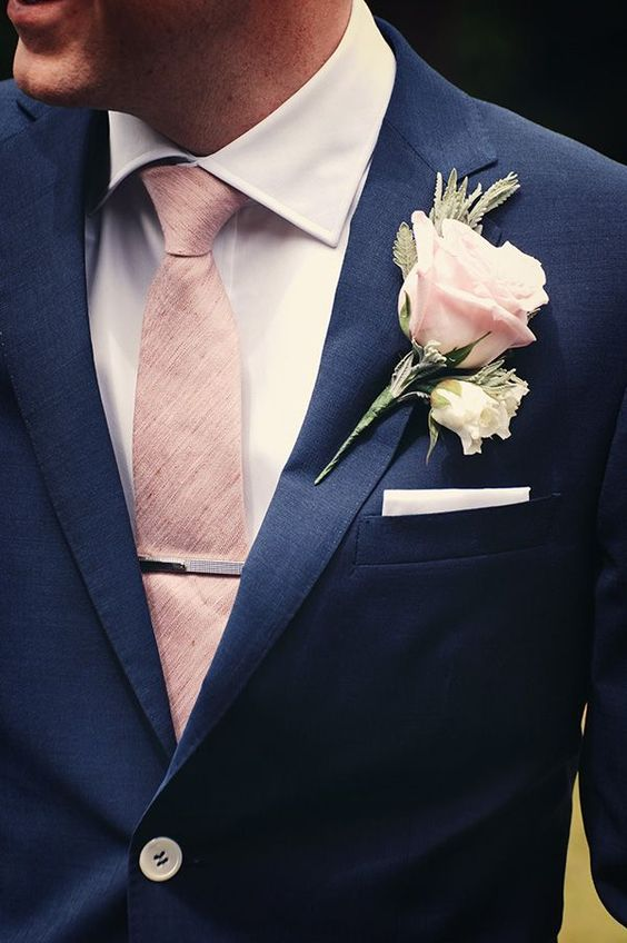 Navy suit, pink heather textured tie, silver tie clip, and rose boutonniere. Perfect summer style for the dapper groom: