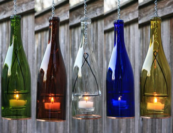 Single wine bottle hanging lantern. Romantic indoor or outdoor lighting. Option of 1 Green, Amber, Yellow, Cobalt Blue, or Clear glass 750ml wine bottle. The chain lengths can easily be changed with a simple pair of needle nose pliers by you at home. The glass votive holder is