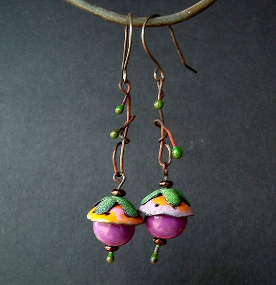 Sugarplum   Torchfired enamel and ceramic rounds. Squiggly enamel copper pins  by Vintajia Adornments, via Flickr