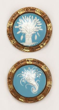 1800's buttons with raised sulfide images. Unusual tinted metal collets. Cooper Hewitt Museum.