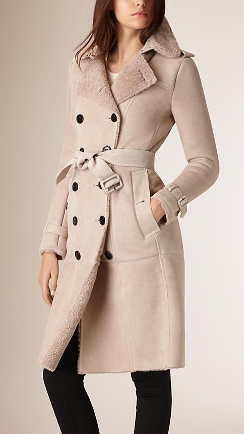 Burberry trench coat cut from warm shearling, with a smooth outer and soft, textured reverse. The slim fit design is paneled and has a signature belted waist and cuffs. Discover the women's outwear collection at Burberry.com