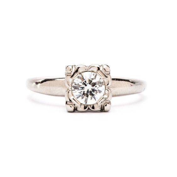 York is a Retro solitaire ring made from 14k white gold and centers a 0 59ct