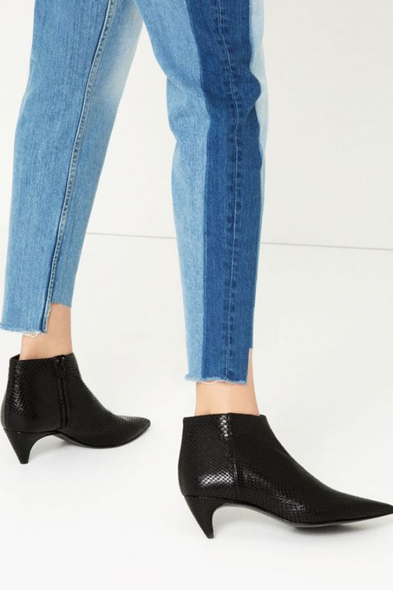 La tendance modifie la forme des talons, pas forcément plus hauts, mais tres fins sans être aiguille. Bottines noires Zara