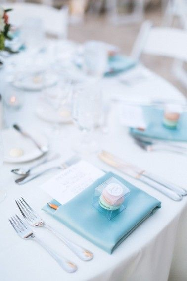 Boxes of macaron favors at each placesetting
