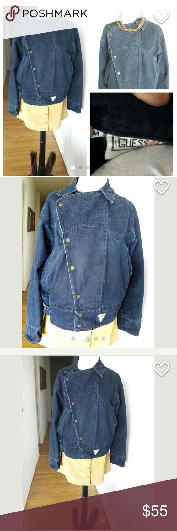 """GUESS Vintage Paris Denim Button up jacket Item details Authentic 90's GUESS Paris Denim Indigo jacket. Dark colored wrap button up jacket. Features 2 front pockets, side ties to adjust tighter or looser. In good condition, all buttons intact,no stains. Size Medium, but please see measurements below for proper fit.   Size: Medium Label Brand: Guess Paris Material: Denim Length: 24.5 """" Inches Across: 19"""" Inches Urban Outfitters Jackets & Coats Jean Jackets"""
