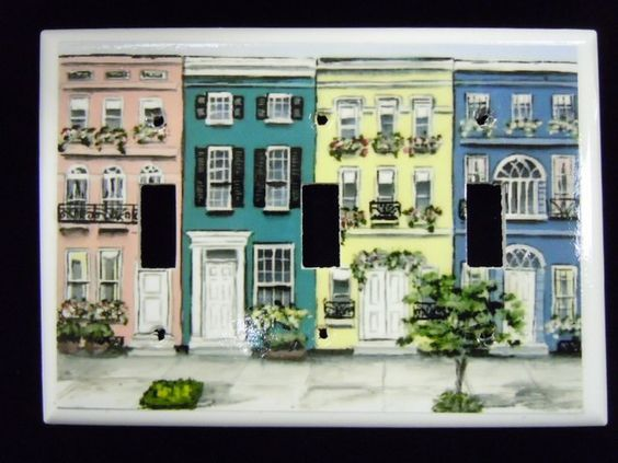 Charleston Switch Plate Charleston Houses Triple $18.00 This modern depiction of Charleston style homes in colors of peachy pink, teal, yellow, and Williamsburg blue are the design of a local artist! Colorful and fun this design can certainly add flare to any room in your home. Not only will you love it, your guests will think they're great too. How often do you really see decorative switch plates like this?!?! Get one for you and a friend today. Standard size.
