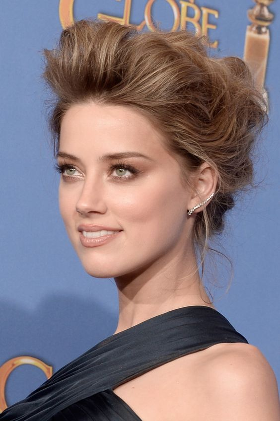 Amber Heard's teased updo and bronzed lids.