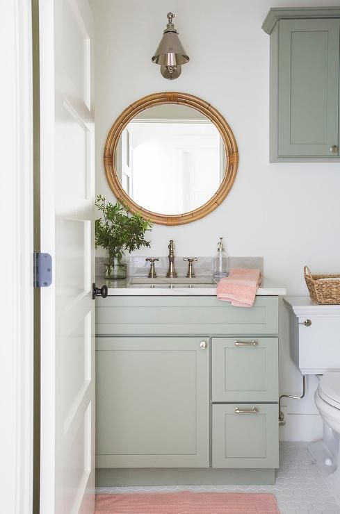 Lovely Pink And Green Bathroom Features A Pink Bath Mat Placed In Front Of A Mint Green Washstand T Green Bathroom Green Bathroom Decor Green Cabinets Bathroom
