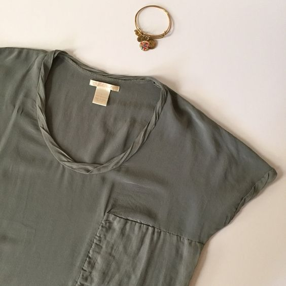 Silk Tee Tunic by Gold Hawk What a beautiful and classic piece to add to any wardrobe. 100% silk and flattering tie on the side. Versatile olive green color. No trades. Offers welcome. Bundle and receive 30% off your entire purchase at checkout automatically, or ask me to create a bundle for you. Happy Poshing! Gold Hawk Tops Tunics