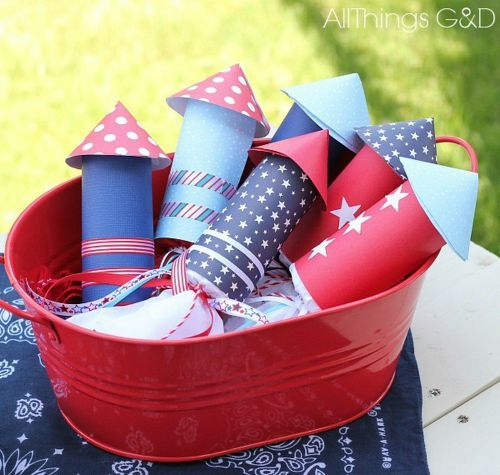 s 13 july 4th decorations that will blow your bbq guests away, crafts, outdoor living, seasonal holiday decor, Make fun TP roll candy rockets for kids