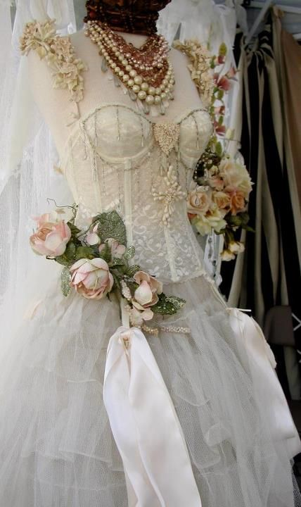 corset on a vintage dressform with pearls and lace