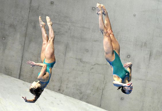 FINA Diving World Cup  Francesca Dallape (L) and Tania Cagnotto of Italy dive in the Women´s Synchronised 3m Springboard Final at the FINA Diving World Cup at the Olympic Aquatics Centre in London
