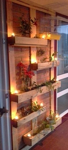 Pallet planters are not that difficult to build. Place vertical beams of pallet on the brick wall for support then fix four by one pallet cases or pallet planter on them. Use lights to decorate them and also hang cages to make the look complete. Fresh plants coming out of these pallets look amazing.: