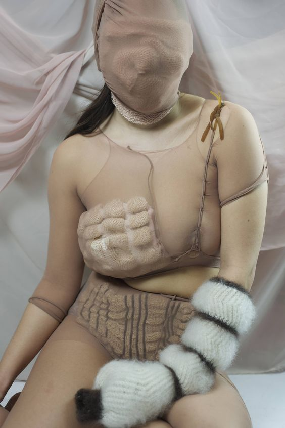 JOSEPHINE COWELL, ROYAL COLLEGE OF ART - This project explores a desire to be wrapped up and concealed, particularly in relation to disability and difference, using applied textiles to shield and comfort.