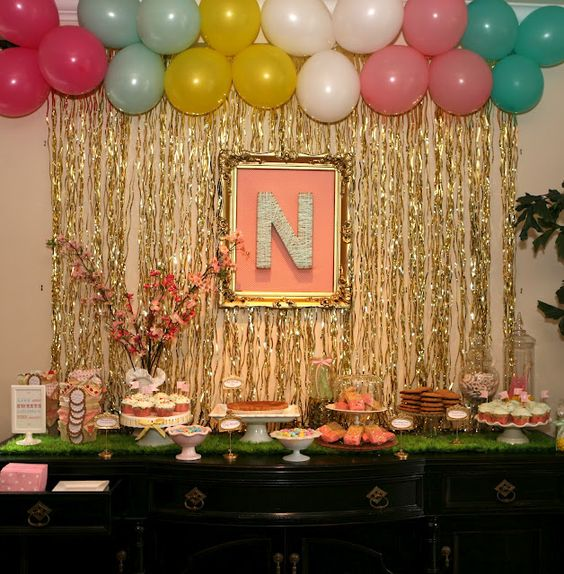 I really like the framed monogram idea.  And the gold, of course.  Other cute touches at this party, too.