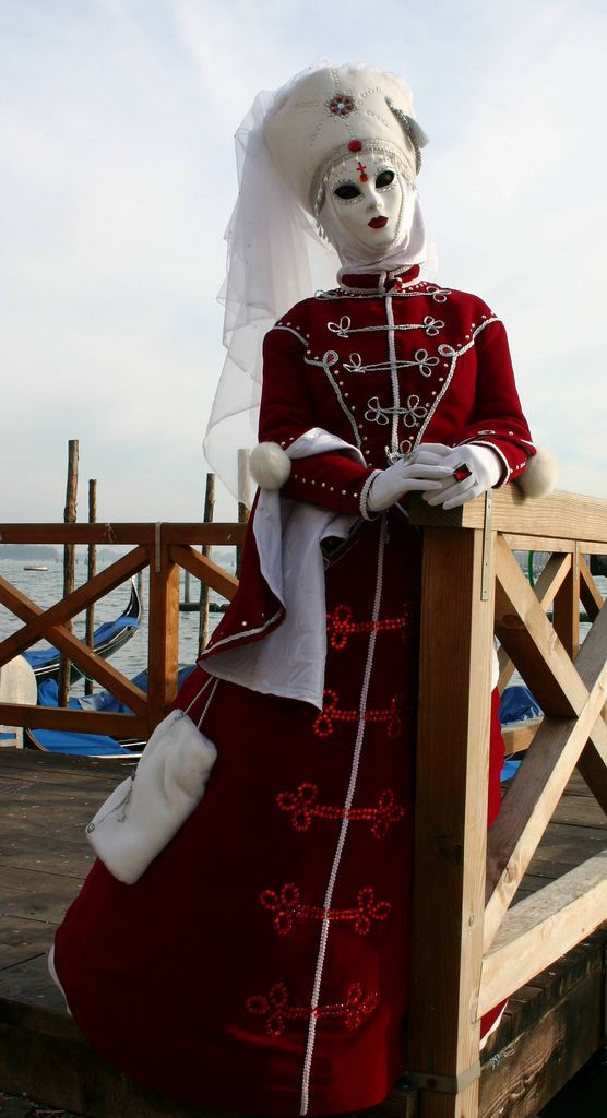 https://flic.kr/p/4uZ6cM | Lady in red and white on a waterfront perch (IMG_3938a) | Taken at the Carnivale in Venice, Italy in January 2008.