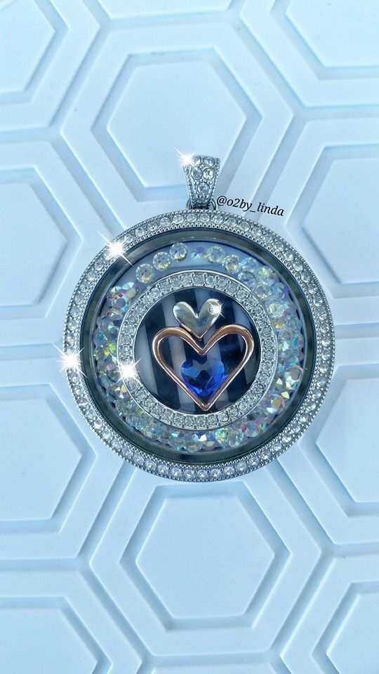 Legacy locket from Origami Owl. This one is big and blingy! Swarovski crystals. Add a long chain and it's gorgeous! https://dreambig.origamiowl.com