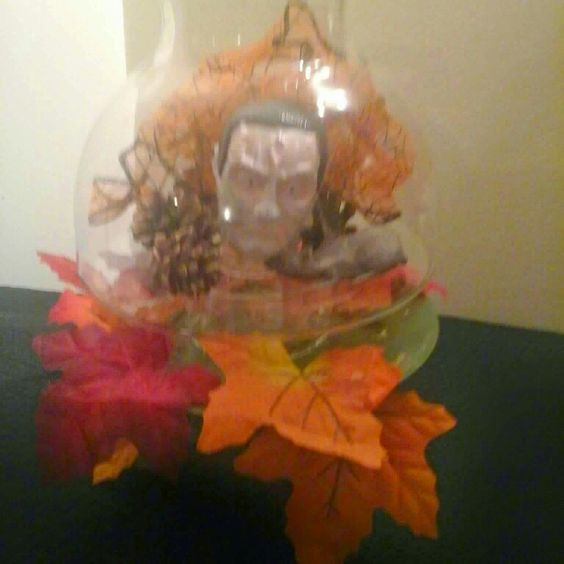 I place halloween decor in a candle holder