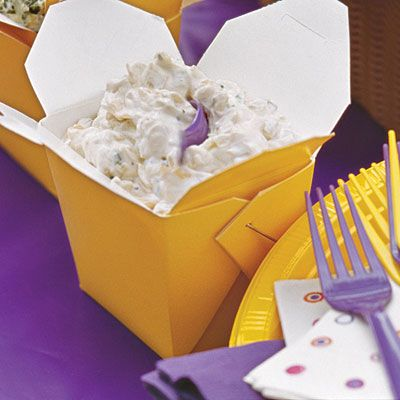 Serve tailgate dips in color-coordinated takeout containers.