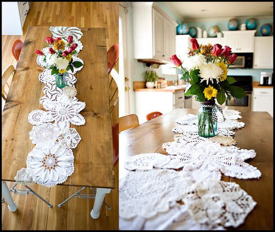 Doily Table Runner  Step 1: Lay out your largest doilies first  Step 2: Fill in with smaller doilies. I used all different shapes and stuck with white and cream colors.  Step 3: Overlap the edges of the big and small doiles so that the small ones aren't always on top.  Step 4: Tack the doilies together using string on the UNDERSIDE. I tied a double knot in several spots using thread and a needle.