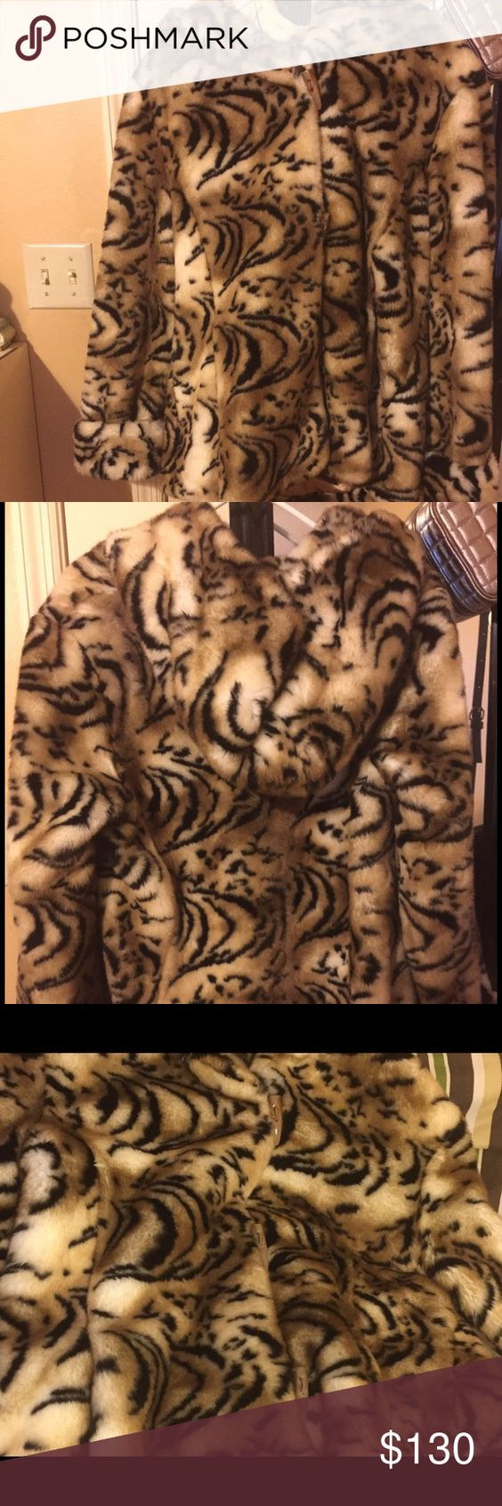 Tiger print faux fur hooded coat This coat a attention eye catcher. Its a size XS from Pamela McCoy tiger print but runs bigger like a extra large in misses. it's hip length roll up sleeves and hooded. I'm selling because I recently moved down south and don't need it anymore. I used to wear it in 0 degree weather and it would keep me nice and warm. Gently worn 5x about a few year old the plush faux fur is in excellent condition. pamela McCoy  Jackets & Coats