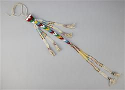 APACHE AWL CASE, ELABORATELY BEADED AND FRINGED ca. 1900, l: 9.25 in., w: 1.5 in. at widest part  Estimate $ 700-900 APACHE AWL CASE, ELABORATELY BEADED AND FRINGED ca. 1900, l: 9.25 in., w: 1.5 in. at widest part    WVQ-12/14