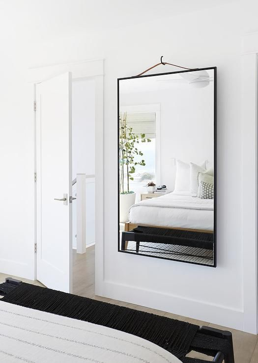 A Brown Leather Strap Mirror Is Hung, Can Mirror Be Placed In Front Of Bed