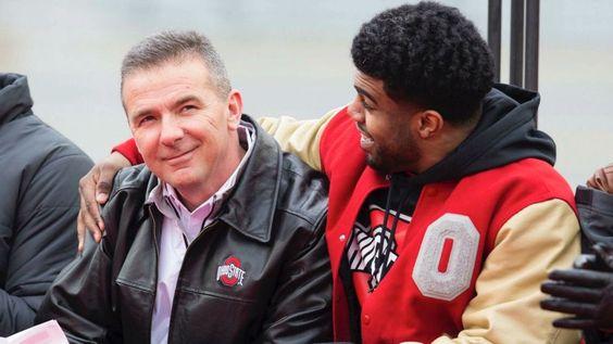 Ohio State Buckeyes running back Ezekiel Elliott (15) hugs head coach Urban Meyer during the National Championship celebration at Ohio Stadium.