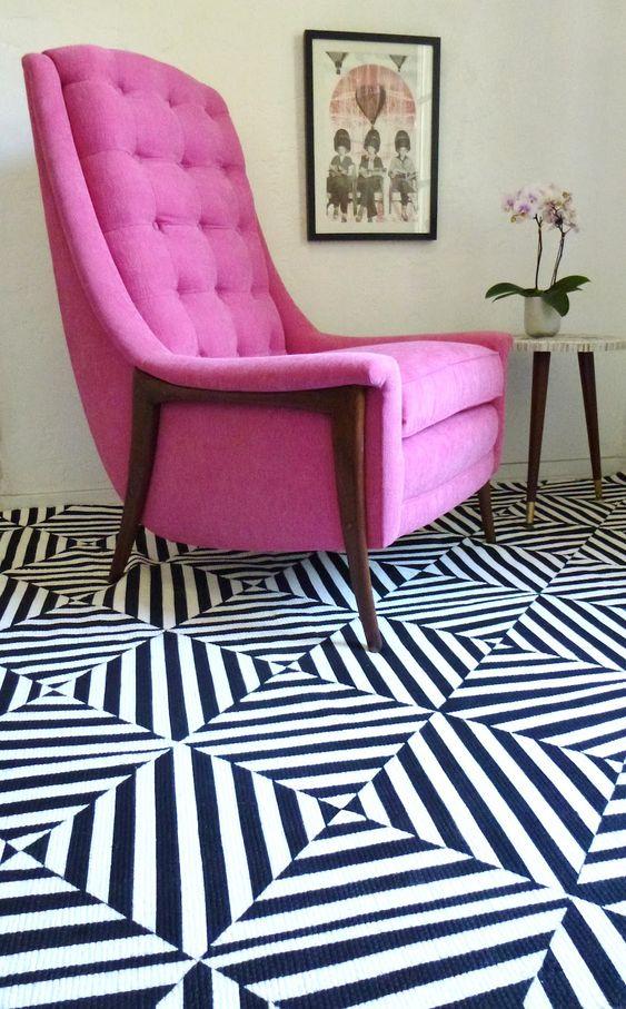 mid-century modern chair + great rug.
