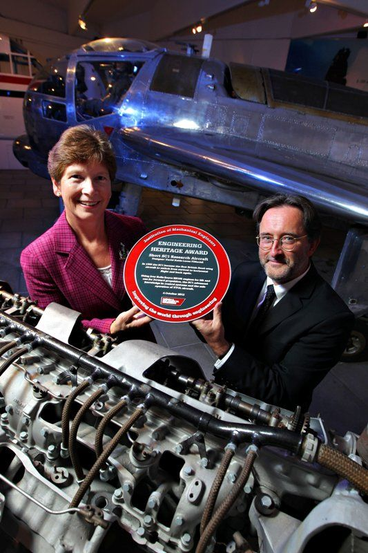 Short SC1 vertical take-off aircraft, October 2012.  Professor Isobel Pollock, President of the Institution of Mechanical Engineers and Dr Jim McGreevy, Director of Collections & Interpretation for National Museums Northern Ireland. Photo courtesy of Press Eye Ltd