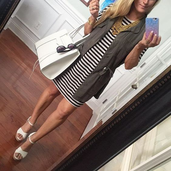 Sunshine and Sequins in a striped dress and olive vest