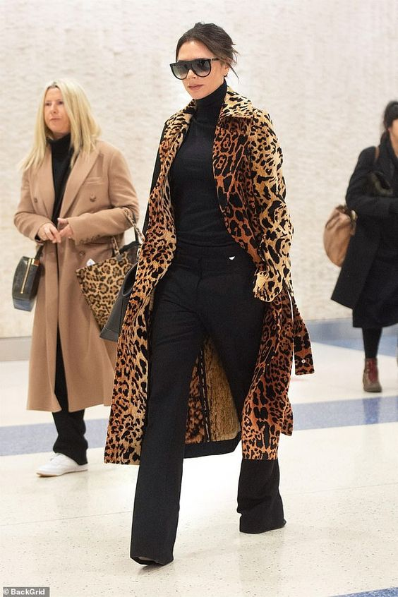 Sassy: Victoria Beckham ensured all eyes would be on her as she strolled through JFK airpo...